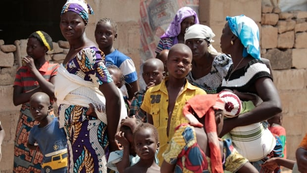 A family that escaped Boko Haram attacks seek shelter in an unfinished in Adamawa, Nigeria on Jan. 31.