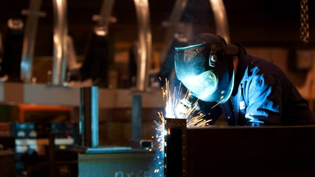 A welder works in a Quebec City factory. People looking for work will be among those watching the January jobless numbers to see whether falling oil has helped or hurt the wider Canadian economy.