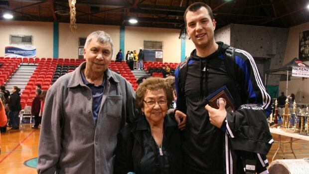 Jared Casey (right) with his father and his grandmother, after his first win with the Skidegate Saints at the All-Native Basketball Tournament in 2012.