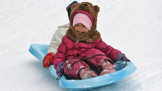 Janina Pinho, 4, barrels down the Chedoke hillside this month. The city of Hamilton is looking at setting up tobogganing zones.