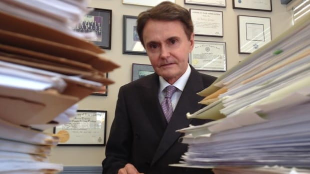 Tony Merchant and his law group are now representing more than 1,000 aboriginal people - with the actual files pictured - who were taken from their families and adopted into white families during the '60s Scoop'.