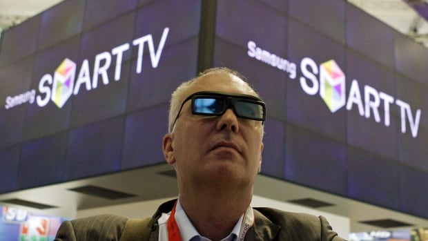 A man watches a presentation of Samsung's voice-recognition SmartTV technology. The electronics company's SmartTV can change channels based on voice commands, but a recent update to Samsung's privacy policy revealed that private conversations picked up by the TV's microphone could be among data collected and sent to a third party.