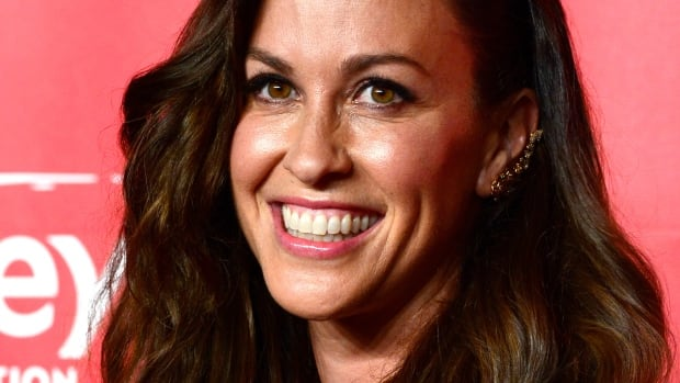 Singer Alanis Morissette attends the 25th anniversary MusiCares 2015 Person Of The Year Gala honoring Bob Dylan at the Los Angeles Convention Center on February 6, 2015 in Los Angeles, California. The annual benefit raises critical funds for MusiCares' Emergency Financial Assistance and Addiction Recovery programs.
