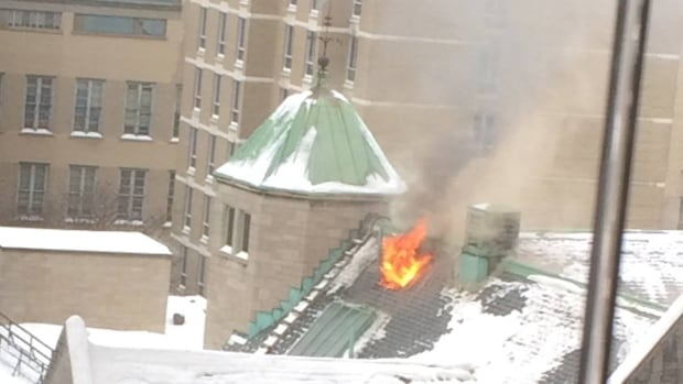 Flames were seen coming from the roof of Royal Victoria College on Tuesday morning.