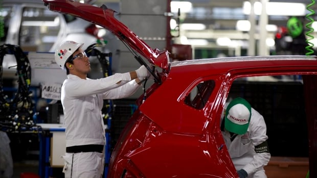Employees work in the new multibillion-dollar Honda car plant in Celaya, in the central Mexican state of Guanajuato. Mexico overtook Canada in auto production in 2014.