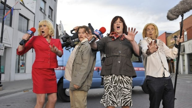 "In this publicity image released by IFC TV, from left, Scott Thompson, Dave Foley, Mark McKinney and Kevin McDonald are shown in a scene from, ""The Kids in the Hall: Death Comes to Town."" (AP Photo/IFC, Michael Gibson)"