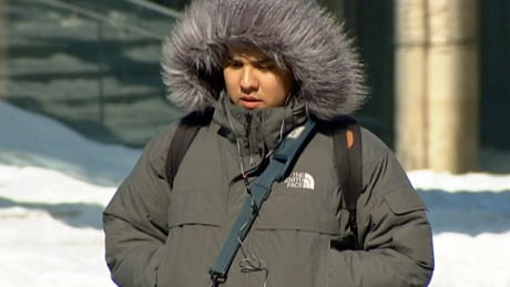 Cold weather shot of person in coat in Toronto on Feb. 15, 2015