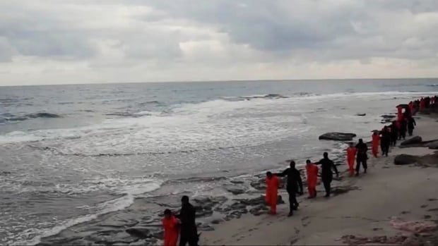 This image made from a video released Sunday by militants in Libya claiming loyalty to ISIS purportedly shows masked militants leading Egyptian Coptic Christians in orange jumpsuits along a beach before they are made to kneel and simultaneously beheaded. The Associated Press could not independently verify the video.