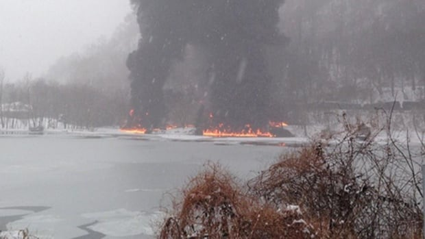 There were reports that at least one of the burning rail cars ended up in the Kanawha River, but CSX Corp. on Tuesday said none of the cars landed there.
