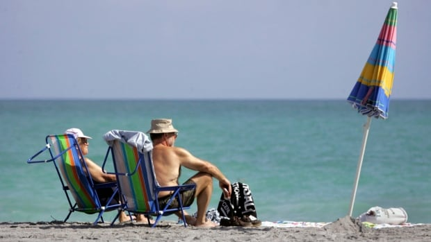 Canadians enjoy the sun on Dania Beach, Fla.  The Canadian Snowbirds Association says the low Canadian dollar isn't stopping their members from making the annual trip south. (AP Photo/The Miami Herald,  Marsha Halper)
