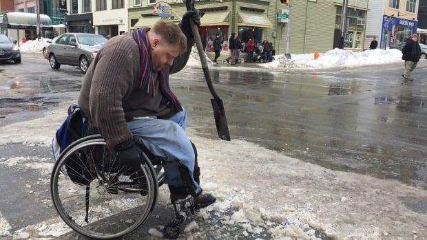 Paul Vienneau, who uses a manual wheelchair, has been unable to get around because of the compact ice on crosswalks and street corners.