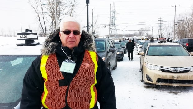 """Aki Vassilatos, a taxi owner and driver for 10 years, protests in Montreal on Feb. 19 against the """"sharing-economy"""" service UberX."""