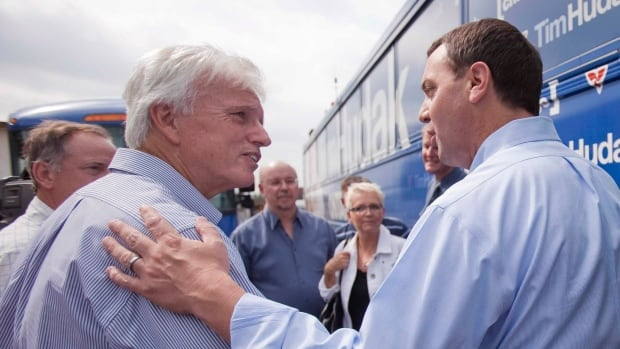 Chatham-Kent-Essex MPP Rick Nicholls, left, seen here in 2011 with Ontario PC Leader Tim Hudak, said Wednesday his disbelief in evolution is 'a personal stance.'