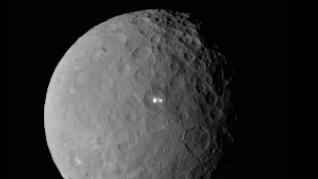 An image taken by NASA's Dawn spacecraft of Ceres on Feb. 19 from a distance of nearly 46,000 kilometres shows that the brightest spot on Ceres has a dimmer companion, which apparently lies in the same basin.
