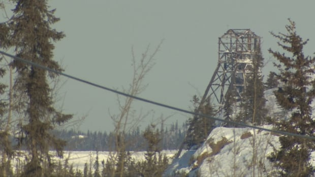 The C-Shaft headframe at Giant Mine is scheduled for takedown this summer due to concerns about safety of the crew cleaning up the mine site.