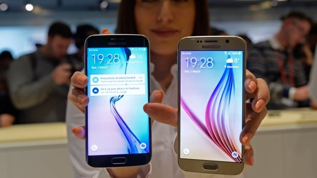 The new Galaxy S6, right, and S6 Edge are displayed during a Samsung Galaxy Unpacked 2015 event on the eve of the Mobile World Congress wireless show in Barcelona, Spain on Sunday.