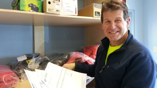 Jon Wynn, owner of Gear Up for Outdoors in Thunder Bay, Ont., sorts through some online orders that make up about a quarter of his business. Many of them are sent to American customers.