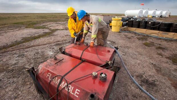 Two men work at the fuel storage site at the proposed Kiggavik uranium mine, near Baker Lake, Nunavut.