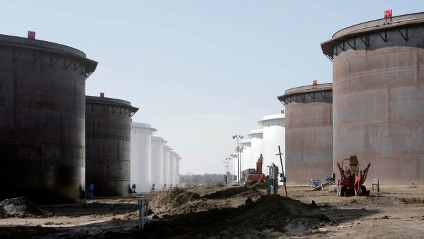 Oil storage tanks are shown at the SemCrude tank farm north of Cushing, Okla. U.S. oil storage is at the highest level in 80 years.