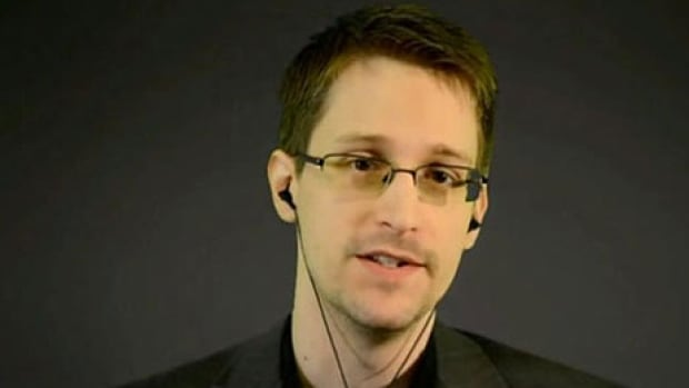 NSA whistleblower Edward Snowden, seen speaking via video link in March, is backing a proposal for a global treaty to scale back government spying on ordinary citizens.