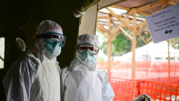 Members of the Canadian Red Cross team suit up at a treatment facility in Sierra Leone in February. A Canadian recruitment drive for medical personnel to go to West Africa has been halted as the number of new Ebola cases there slows.
