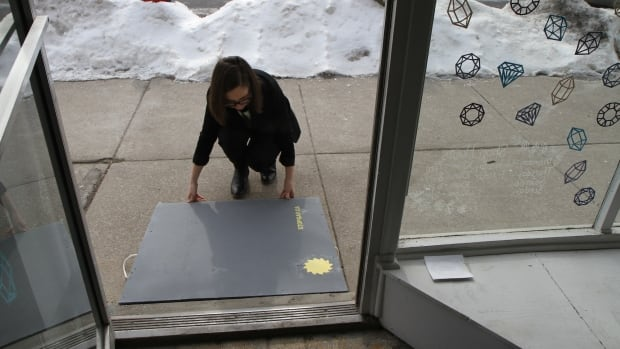 Hollie Pocsai tests out her new ramp at her boutique White Elephant in Westdale.