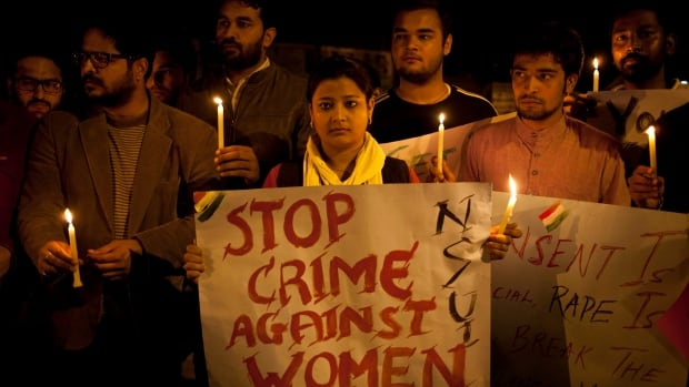 Indian youth hold candles during a protest against sexual violence in Delhi last month. Many women allege police dismiss rape allegations and refuse to register cases.
