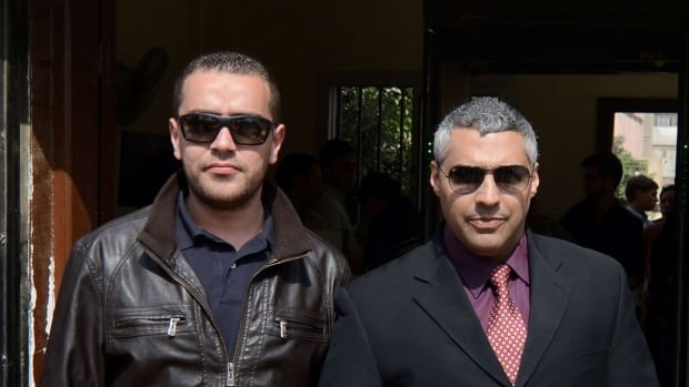 The retrial of Canadian Mohamed Fahmy, right, and Egyptian Baher Mohammed, two Al-Jazeera English journalists who face terror-related charges in a case widely criticized by human rights organizations and media groups, has been postponed yet again to March 19.