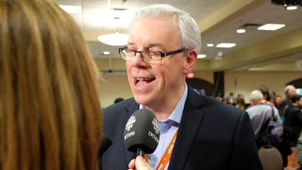 Premier Greg Selinger talks with CBC's Marcy Markusa after winning the Manitoba NDP leadership election Sunday.