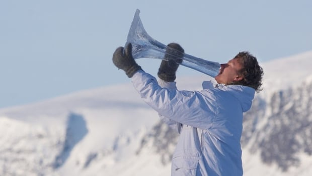 Norwegian Terje Isungset plays an instrument made entirely of ice. The musician says it took him most of Saturday to carve a similar horn in Iqaluit, because the ice was so prone to breaking.
