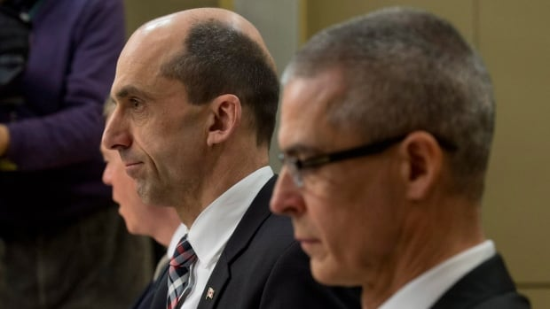 Public Safety Minister Steven Blaney, left, and CSIS director Michel Coulombe wait to speak about Bill C-44 at the Senate national security committee hearing Monday.