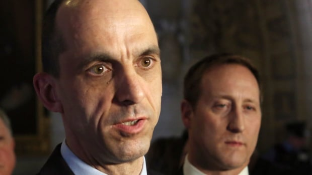 Public Safety Minister Steven Blaney, left, talks to reporters on Parliament in Ottawa as Justice Minister Peter MacKay, right, looks on. Blaney's proposed legislation to give a Canadian intelligence agency sweeping new powers will be the focus of the public safety committee Monday evening.
