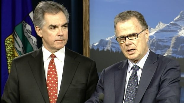 Alberta Premier Jim Prentice and Education Minister Gordon Dirks talk to reporters Tuesday after the passage of Bill 10, which will allow gay-straight alliances in any school where students want them.
