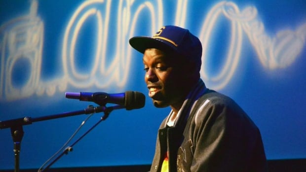 """Shad performing as part of DNTO's live """"Unexpected Gifts"""" show in Vancouver on October 19, 2011."""