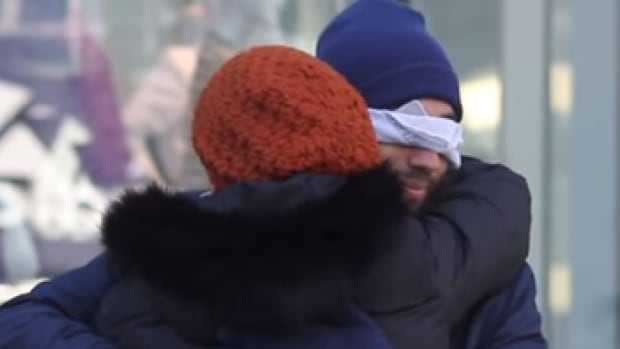 The original Blind Trust Project video shot in Toronto's Yonge-Dundas Square asked strangers to hug a Muslim in a public space to help break down barriers and raise awareness about Islamophobia.