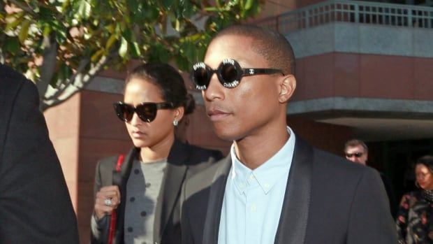 Pharrell Williams leaves a U.S. federal court after testifying at trial in Los Angeles. Experts are skeptical of the jury verdict ruling that Williams and Robin Thicke's 2013 hit song 'Blurred Lines' plagiarized Marvin Gaye's 1977 hit 'Got To Give It Up.'