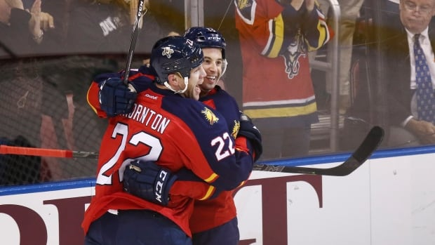 Florida Panthers' Derek MacKenzie (right) opened scoring in a 4-2 victory over the visiting Winnipeg Jets.