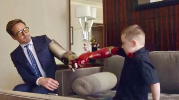 Robert Downey Jr. delivers a real bionic arm to a boy who needs one.