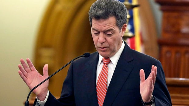 """""""Servant leader"""" and one-time presidential candidate Sam Brownback delivers his state of the state address at the Kansas Statehouse in Topeka in January. Having begun what he called 'a real live experiment' with tax cuts, Kansas is currently running a massive deficit."""