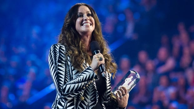 Alanis Morissette, seen here during the 2015 Juno Awards, is taking over from actress Molly Ringwald as advice columnist for the Guardian Weekend magazine.