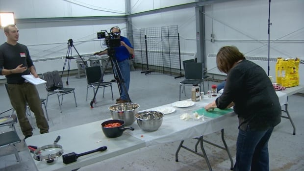 """Kyle Napier, left, who manages the N.W.T. Cree Language Program for the Northwest Territory Métis Nation, attends filming of an episode of """"Good Eating"""" in Hay River."""