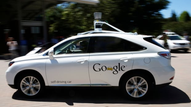 A Google self-driving vehicle drives around a parking lot. Some companies have predicted they will be able to sell automated vehicles in 2020.
