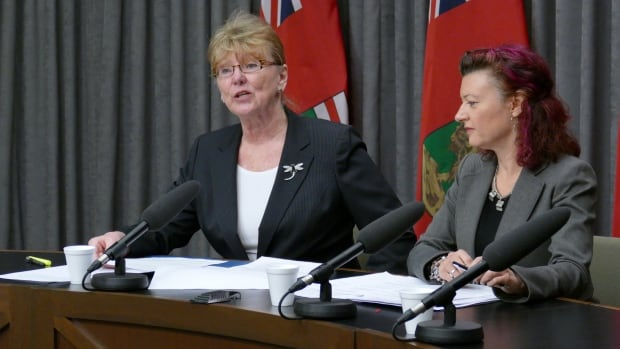 Manitoba Labour Minster Erna Braun, left, and Health Minister Sharon Blady speak to reporters about the fire safety task force report on Tuesday in Winnipeg.