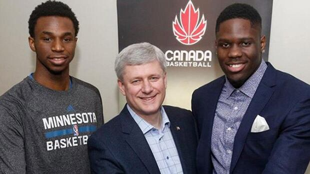 Prime Minister Stephen Harper, centre, met with Canadian basketball players Andrew Wiggins, left, and Anthony Bennett, right, both of the Minnesota Timberwolves on Wednesday at the Air Canada Centre in Toronto, Ont., before a game against the Toronto Raptors.