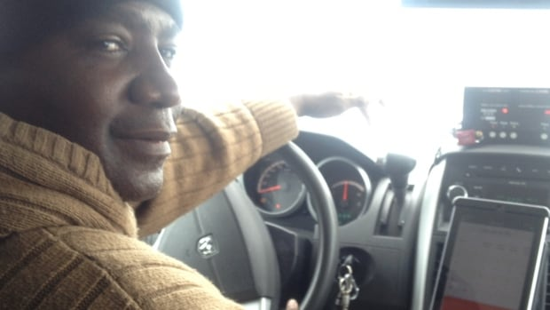 Nelson Muchekeni shows off his new tablet system, which is dash-mounted in his cab.