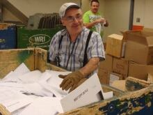 Frank Charbonneau has sorted and shred paper for Library and Archives Canada in Ottawa for 35 years. In this photo he is with his sister, Ann Carmichael.