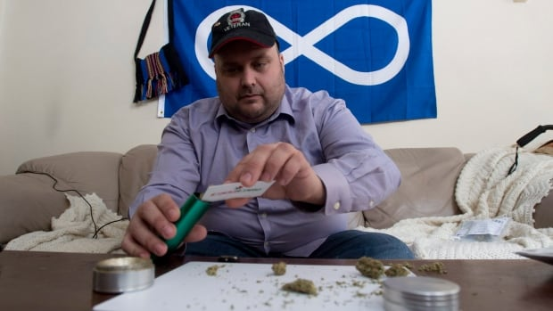 Clayton Goodwin prepares medicinal marijuana at his apartment in Ottawa on Friday. The cost of providing medical pot to the Canada's injured soldiers under a Veterans Affairs program jumped to more than $4.3 million this fiscal year.