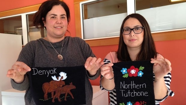 Joella Hogan (left) and Kaylie-ann Hummel hold examples of Northern Tutchone beadwork that will be displayed in the Na-cho Nyak Dun offices.