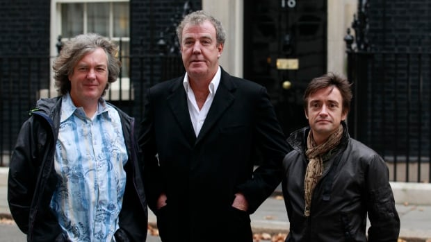 Former Top Gear hosts (from left) James May, Jeremy Clarkson and Richard Hammond are seen in 2011. Clarkson has apologized to and settled a lawsuit with a BBC producer over an off-set altercation that resulted in his firing.