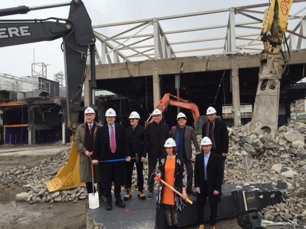 Mayor John Tory and others stand at the site where the Guvernment nightclub once stood.